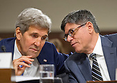 """United States Secretary of State John F. Kerry and US Secretary of the Treasury Jacob Lew share some thoughts as they give testimony before the US Senate Committee on Armed Services concerning """"Impacts of the Joint Comprehensive Plan of Action (JCPOA) on U.S. Interests and the Military Balance in the Middle East"""" on Capitol Hill on Wednesday, July 29, 2015.<br /> Credit: Ron Sachs / CNP"""