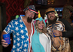 Apple, Heidi and Steven during the Onesie Crawl held on Saturday night, Nov. 18, 2017 in downtown Reno.