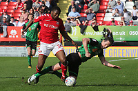 Josh Morris of Scunthorpe United is sent flying after a challenge from Charlton Athletic's Anfernee Dijksteel during Charlton Athletic vs Scunthorpe United, Sky Bet EFL League 1 Football at The Valley on 14th April 2018