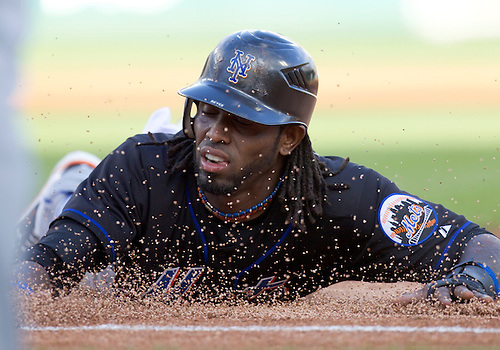 June 28, 2011:  New York Mets shortstop Jose Reyes (#7) dives back into first base during MLB game action between the New York Mets and the Detroit Tigers at Comerica Park in Detroit, Michigan.  The Mets defeated the Tigers  14-3.