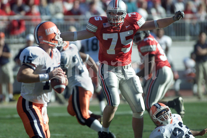 Ohio State's Simon Fraser (75) looms over Illinois quarterback Kurt Kittner. Fraser sacked him for a loss of six yards on this third quarter play Nov. 17, 2001. (John Falkenberg/for the Dispatch)