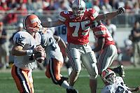 Ohio State's Simon Fraser (75) looms over Illinois quarterback Kurt Kittner. Fraser sacked him for a loss of six yards on this third quarter play Nov. 17, 2001. (John Falkenberg/for the Dispatch)