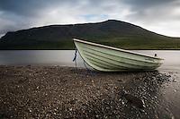 Row boat on shore of lake Teusjaure outside Teuesjaure hut, Kungsleden trail, Lapland, Sweden