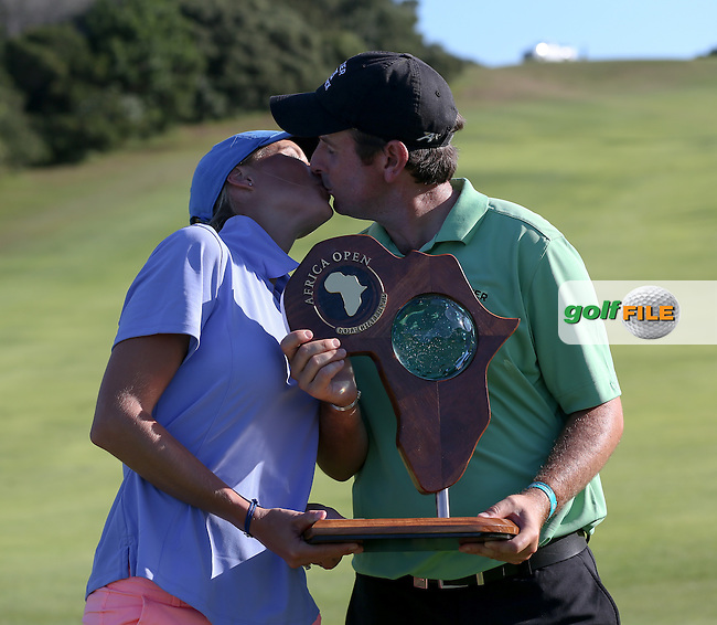Thomas Aiken (RSA) and wife Kate who caddied for him for all rounds, take a celebratory kiss as winners of The Africa Open 2014 at the East London Golf Club, Eastern Cape, South Africa. Picture:  David Lloyd / www.golffile.ie
