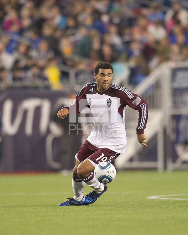Colorado Rapids forward Andre Akpan (19) dribbles. In a Major League Soccer (MLS) match, the New England Revolution tied the Colorado Rapids, 0-0, at Gillette Stadium on May 7, 2011.