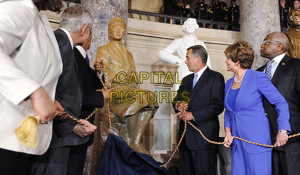 United States President Barack Obama, with guests and members of Senate and Congress including Speaker of the U.S. House John Boehner (Republican of Ohio) unveil the statue of Rosa Parks in Statuary Hall of the United States Capitol February 27, 2013 in Washington, DC. .half length cloth fabric rope.CAP/ADM/CNP/OD.©AdMedia/Capital Pictures.