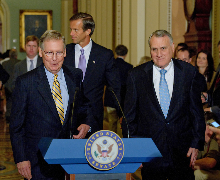WASHINGTON, DC - August 03: Senate Minority Leader Mitch McConnell, R-Ky., Senate Republican Policy Committee Chairman John Thune, R-S.D., and Senate Minority Whip Jon Kyl, R-Ariz., during a news conference after the Republican policy luncheon. (Photo by Scott J. Ferrell/Congressional Quarterly)