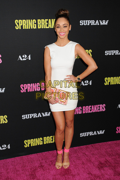 Cara Santana.At the 'Spring Breakers' Los Angeles Premiere held at Arclight Cinemas, Hollywood, California , USA, .14th March 2013..full length white dress sleeveless hand on hip pink ankle strap sandals beige nude open toe hair up bun embroidered clutch bag.CAP/ADM/BP.©Byron Purvis/AdMedia/Capital Pictures.