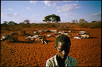 'Bore Hole 11', NE Kenya, March 2006.Saddam Sura is a 'drop-out', one of million semi-nomadic herdsmen who are leaving the bush to come and live in camps near villages as their livestock is decimated by a persistent drought, abandonning their traditional lifestyle.