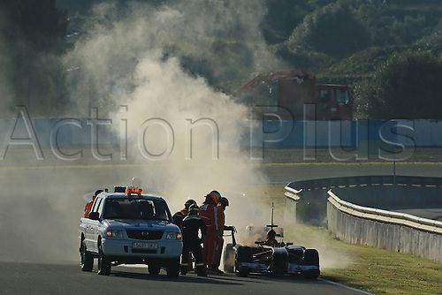 08.02.2013. Jerez, Spain. Formula 1 vehicle and team winter testing event.  Pedro de la Rosa of Ferrari F1 Team  causing a red flag after his Ferrari stops on track in clouds of smoke from an engine fire.