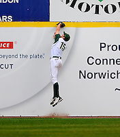 University of Oregon right fielder leaps to make catch in the top of the ninth inning.