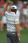 May 8,2011 - Lucas Glover raises his fist in the air to acknowledge the cheers of fans after sinking his putt in the play off.  Lucas Glover wins the tournament in sudden death over Jonathan Byrd at Quail Hollow Country Club,Charlotte,NC.