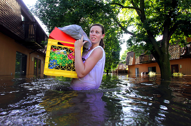 Laura Eggers wades through waist-deep water while salvaging some of her belongings from her apartment on South 5th St. in Ames Wednesday, August 11, 2010. Flood levels for the Skunk River and Squaw Creek in Ames crested at record levels Wednesday, after eight inches of rain fell overnight, inundating the city and the campus of Iowa State University.