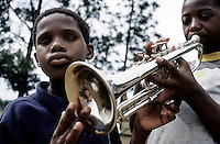 KLIPRIVER, SOUTH AFRICA APRIL 13: Luvo Toto, age 13, (L) a blind boy, touches a trumpet as Sicelo Kunene, age 14, practice on the instrument in a brass band at Sibonile at Sibonile (means: we have seen) School for the Blind on April 13, 2003 at Sibonile (means: we have seen) School for the Blind in Klipriver, south of Johannesburg, South Africa. A Johannesburg music group visits them about once a month giving the children a chance to play instruments and dance. A blind woman founded the school in 1994. The school has about 125 students from disadvantaged communities around South Africa. Many of the children have faced rejection from their families and communities, and at Sibonile they have a chance for a good education. .(Photo: Per-Anders Pettersson)....