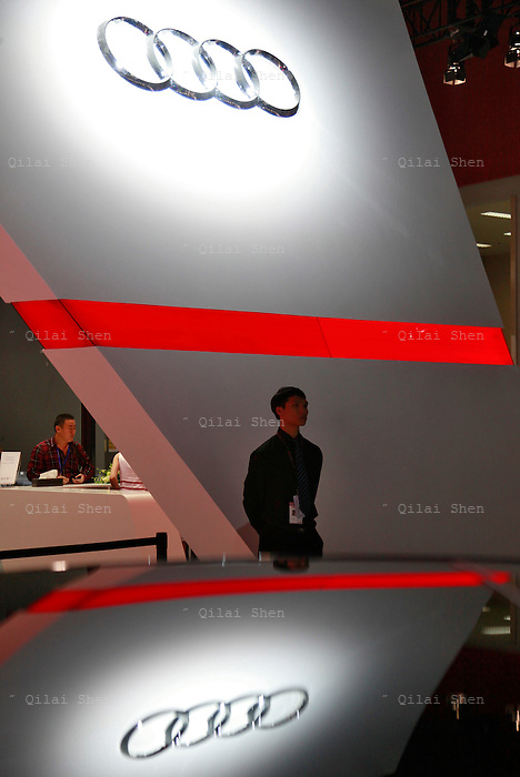 A exhibition staff walks under the Audi AG logo during the China ( Guangzhou) International Automobile Exhibition in Guangzhou, Guangdong Province, China, on Monday, Nov. 21, 2011. Despite signs of slowing, China remains the largest and fastest growing market for international car makers, especially in the luxury sector.