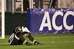 14 November 2008: Boston College's goalkeeper Chris Brown sits dejected on the field after his team gave up an own goal in the second half. The University of Maryland defeated Boston College 1-0 at WakeMed Stadium at WakeMed Soccer Park in Cary, NC in a men's ACC tournament semifinal game.