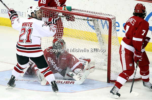 Matt White reacts to UNO's first goal of the game. Looking on are Wisconsin's Tyler Barnes and goalie Scott Gudmandson. The goal by Joey Martin (not pictured) tied the game at 1-1 in the second period. No. 16 UNO beat No. 7 Wisconsin 4-1 in front of a school-record crowd of 15,137 Friday night at Qwest Center Omaha.  (Photo by Michelle Bishop)
