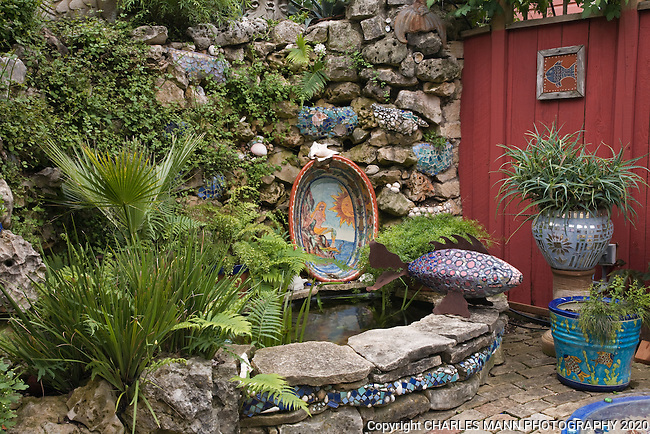 The garden of Lucinda Hutson in Austin, Texas, is a study in making all parts of the entire space participate in the garden experience with vivid  colors and textures on the walls, gate, walks and even the house itself.
