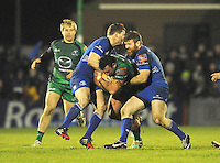 4th January 2014; Denis Buckley, Connacht, is tackled by Brian O'Driscoll and Gordon D'Arcy, Leinster. Rabodirect Pro12, Connacht v Leinster, Sportsground, Galway. Picture credit: Tommy Grealy/actionshots.ie.