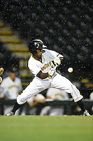 Bradenton Marauders outfielder Raul Fortunato (35) lays down a bunt in the rain during a game against the Jupiter Hammerheads on April 17, 2014 at McKechnie Field in Bradenton, Florida.  Bradenton defeated Jupiter 2-1.  (Mike Janes/Four Seam Images)