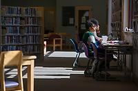 NWA Democrat-Gazette/J.T. WAMPLER Qyxiaan Elliott of Fayetteville studies Monday March 5, 2018 at the Springdale Public Library.