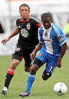WASHINGTON, D.C. - AUGUST 19, 2012:  Nick DeLeon (18) of DC United chases after Michael Lahoud (13) of the Philadelphia Union during an MLS match at RFK Stadium, in Washington DC, on August 19. The game ended in a 1-1 tie.