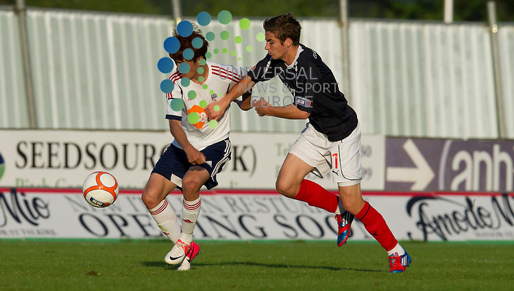 Luke Leahy of Falkirk challenges for the ball against Chung Yong Lee of Bolton during the pre-season friendly between Falkirk and Bolton Wanderers at The Falkirk Stadium. 25 July 2012. Picture by Ian Sneddon / Universal News and Sport (Scotland). All pictures must be credited to www.universalnewsandsport.com. (Office) 0844 884 51 22.