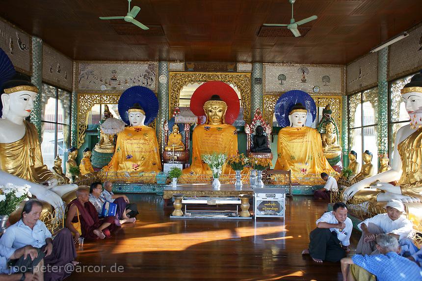 worshippers in buddha temple on Shwedagon pagoda complex, Yangon, Myanmar, 2011