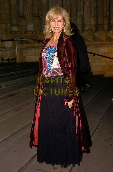 JOANNA LUMLEY.The Festival Trees gala dinner, Natural History Museum, London, England..December 4th, 2007.full length black skirt purple burgundy velvet jacket  blue bow.CAP/CAN.©Can Nguyen/Capital Pictures