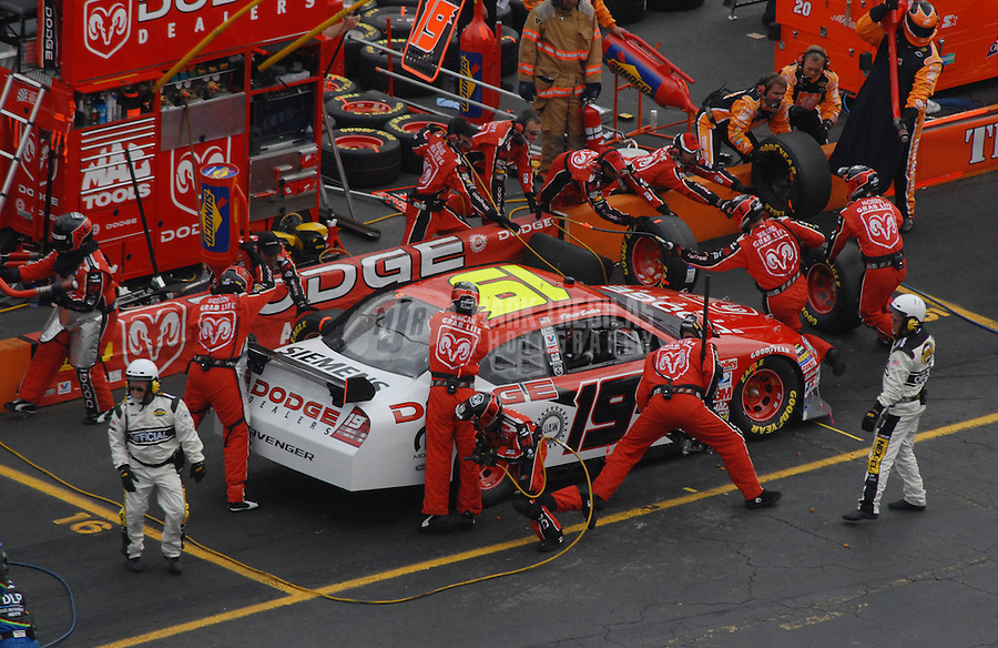 Apr 1, 2007; Martinsville, VA, USA; Nascar Nextel Cup Series driver Elliott Sadler (19) pits during the Goody's Cool Orange 500 at Martinsville Speedway. Martinsville marks the second race for the new car of tomorrow. Mandatory Credit: Mark J. Rebilas