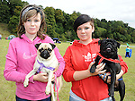 Jodie Mullhall and Aoife Callan pictured with Pugs Roger and Ruby at the Ladywell Fete held in the grounds of Slane castle. Photo: www.pressphotos.ie