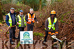 Johnny McGuire with Paddy McGuire, Dave O'Connor and Diarmuid O'Connor who are clearing rhodendrums with Mountain Meithel in Killarney National Park on Tuesday