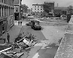 Bank and Riverside Streets as they look 10 days after the flood. Private firms and the Army Corps of Engineers, totaling more than 1,100 persons, have been tackling the clean-up job. 06 September 1955.