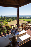 USA, Oregon, Willamette Valley, a couple tastes wine out on an outdoor patio at the Domaine Drouhin Vineyard, Dundee