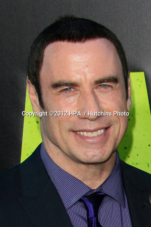 """LOS ANGELES - JUN 25:  John Travolta arrives at the """"Savages"""" Premiere at Village Theater on June 25, 2012 in Westwood, CA"""