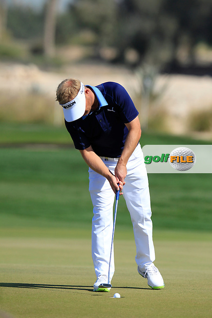 Soren KJELDSEN (DEN) putts on the 9th green during Saturday's Final Round of the 2015 Commercial Bank Qatar Masters held at Doha Golf Club, Doha, Qatar.: Picture Eoin Clarke, www.golffile.ie: 1/24/2015