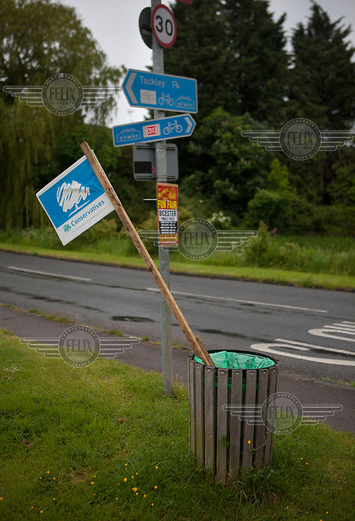 A Conservative placard stands in a rubbish bin in the Oxfordshire village of Kirtlington, the day after the UK Independence Party's successful night in the European elections, at the expense of the 3 main parties.