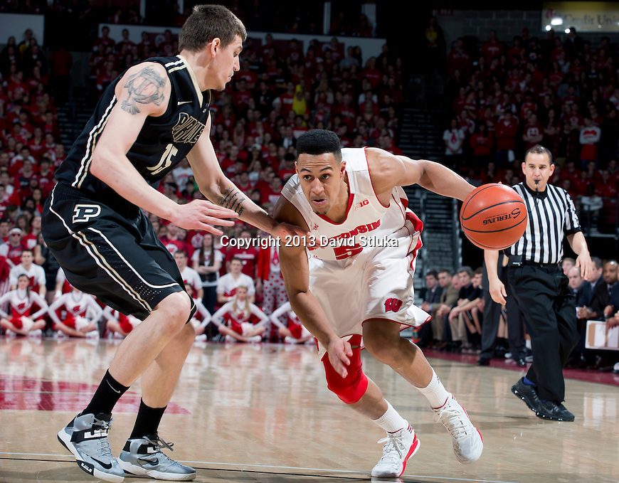 Wisconsin Badgers forward Ryan Evans (5) handles the ball during a Big Ten Conference NCAA college basketball game against the Purdue Boilermakers Sunday, March 3, 2013, in Madison, Wis. Purdue won 69-56. (Photo by David Stluka)