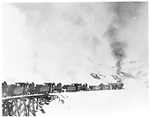 Four engines pushing D&amp;RG rotary snow plow OM across trestle.<br /> D&amp;RG  Cumbres, CO