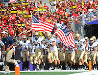 Navy players enter the field at the M&T Bank in Baltimore, MD on Monday, September 6, 2010. Alan P. Santos/DC Sports Box