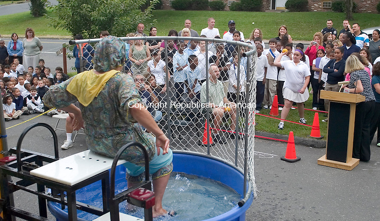 WATERBURY, CT. 12 September 2008-091208SV03--Principal Kathy Stamp waits to get dunked at Generali Elementary School in Waterbury. Stamp allowed students a chance to sink her in a dunk tank as a reward for passing all sections of the state's standardized tests.<br /> Steven Valenti Republican-American