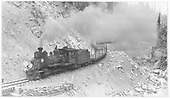 RGS locomotive #42 working upgrade over bridge 64-A hauling empty log cars.<br /> RGS  Burns Canyon, CO  Taken by Perry, Otto C. - 9/1/1940