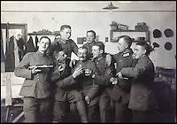 BNPS.co.uk (01202) 558833<br /> Picture: collect<br /> <br /> An incredible photo album showing German First World War pilots quoffing champagne and getting drunk in their mess have been discovered. Coming just 11 years after the first ever flight by the Wright brothers, air warfare was a new but risky concept at the start of the Great War -- The men of the Royal Flying Corps' used the unofficial motto of 'live for today, tomorrow we die' such was the deadly nature of their job. Judging by the dozens of the black and white snaps that have emerged, it seems their German counterparts adopted a similar attitude to life.