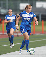 Boston Breakers forward Katie Schoepfer (12) looks to pass. In a National Women's Soccer League (NWSL) match, Seattle Reign FC (white) defeated Boston Breakers (blue), 2-1, at Dilboy Stadium on June 26, 2013.