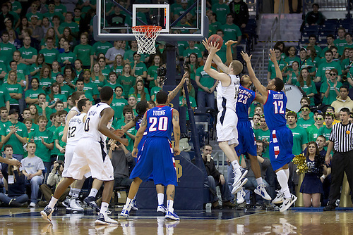 Notre Dame guard Scott Martin (#14) goes up for a shot in first half action of NCAA Men's basketball game between DePaul and Notre Dame.  The Notre Dame Fighting Irish defeated the DePaul Blue Demons 84-76 in game at Purcell Pavilion at the Joyce Center in South Bend, Indiana.