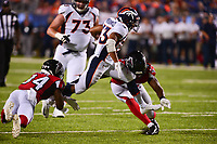Canton, Ohio - August 1, 2019: Denver Broncos running back Khalfani Muhammad #33 runs the ball during a pre-season game against the Atlanta Falcons at the Tom Benson Hall of Fame stadium in Canton, Ohio August 1, 2019. This game marks start of the 100th season of the NFL. (Photo by Don Baxter/Media Images International)