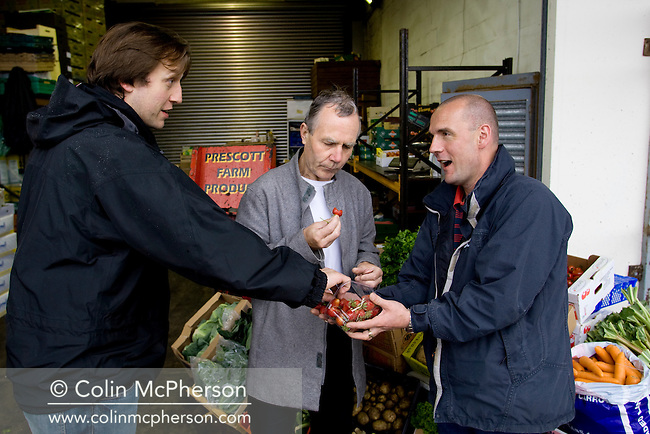 Nick Evans (right), a fruit and vegetable wholesaler pictured at his stall at the  Old Meat Market in Liverpool, north-west England with local chefs Tom Gill and Paddy Byrne two of his regular clients. The daily market caters for wholesale and individual customers from across the region.