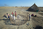 Villagers work on a new house in Dong Boma, a Dinka village in South Sudan's Jonglei State, on April 12, 2017. Most of the villagers recently returned home after being displaced by rebel soldiers in December, 2013, and they face serious challenges in rebuilding their village.<br /> <br /> The Lutheran World Federation, a member of the ACT Alliance, is helping villagers restart their lives with support for housing, livelihood, and food security.