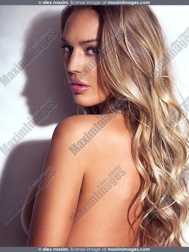Sensual beauty portrait of a sexy glamorous woman with long blond hair