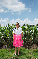 Ana Karen Cruz Casiano poses for a photo on a roadside in San Antonio La Cienga the Mazahua indigenous community near San Felipe del Progreso, in the Estado de mexico, Mexico